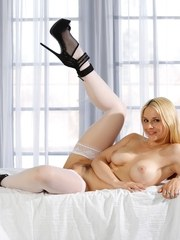 Hot blonde model Sarah Vandella flaunts her sexy ass in white stockings