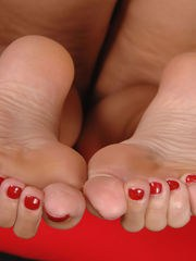 Sexy lezzies Cherry Jul and Lucky play foot games between eating pussy