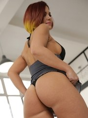 Solo girl Katie Fuckdoll flaunts her juicy ass in a black thong