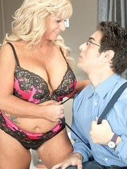 Chunky granny Zena Rey seduces the boy next door in matching bra and panties