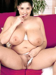 BBW Kerry Marie pulls her huge tits out from underneath a white bra