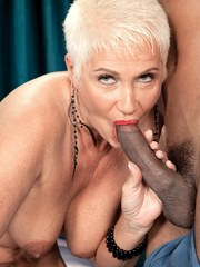 Hot granny Trinity Powers goes about draining the jizz from a black cock