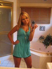 Blonde chick Ariana Armani snaps off selfies as she strips in bathroom mirror