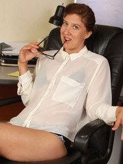 Older secretary Valentine removes her glasses and clothes to showcase her bush