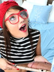 Teen flute player Adria Rae gives head wearing a red beret and glasses