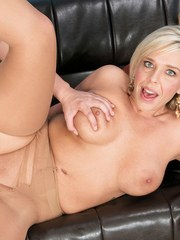 Older blond mom Carey Riley takes it up the ass from a young boy in tan nylons