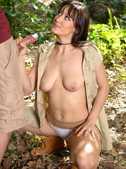 Brunette chick Meko Lilly gives a blowjob in the forest while on safari