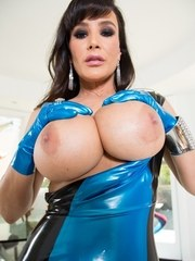 Solo model Lisa Ann releases her big tits and butt from a latex dress