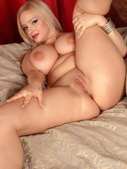 Blonde solo model Sophie Mae rubs lotion into her huge all natural boobs