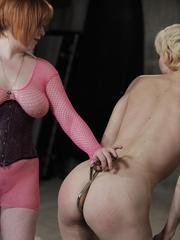 Redhead dyke inserts anal hook into her blonde sex slave