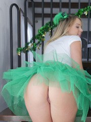 Cute blonde girl Alexis Adams removes her St Patricks day outfit