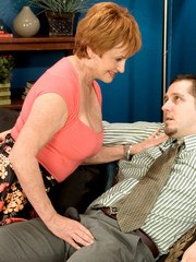 Redheaded grandmother receives a creampie after successfully seducing a man