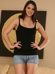 Latina amateur in denim shorts is soon naked and fingering her teen pussy