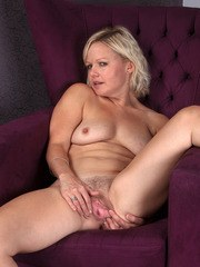 Blonde housewife removes her dress and undies to display her beaver