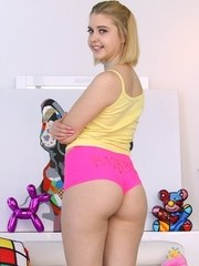 Sweet blonde girl shows of her juicy ass in thong underwear and knee socks