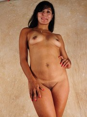 Older Latina lady shows off the pink of her snatch after getting naked