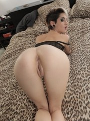 Young Latina girl Mey Madness sheds her black lingerie for nude posing on bed