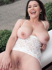 Solo model Aurora Rose unleashes her big natural tits on patio above the city