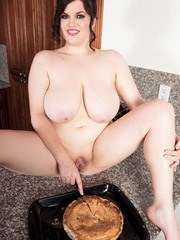 Chubby female with huge tits enjoys a slice of pie in the nude