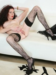 Middle-aged brunette woman shows off her ass and snatch in sexy stockings