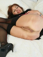 Redheaded nan shows off her snatch and anus in back seam stockings and heels