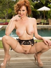 Redhead MILF Veronica Avluv strips to back seam nylons and garter by a pool