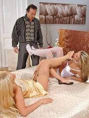 Hot blonde in nylons invite a man to join their foot fetish fun