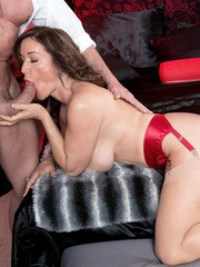 Big titted female Rachel Steele sucks off a cock in tan stocking and red heels
