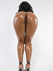 Hot ebony MILF Megan Vaughn flaunts her oiled booty after swimsuit removal
