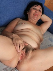 Chubby older lady showcases her hairy vagina after removing her clothes