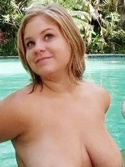 Chubby blonde girl Ellie May pleases guy with her big tits and mouth in a pool