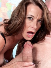 Mature schoolteacher Mimi Moore seduces a coworker in her classroom