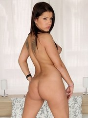 Brunette chick Angel Rivas exposes her her big tits and bare ass as she strips