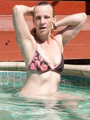 Older woman Cody Hunter slips off her bikini after going for a swim