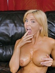 Blonde MILF Christie Stevens blows a guy and spits out the cum afterwards