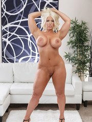 Blonde bombshell Alura Jenson uncovers her nice melons and big butt