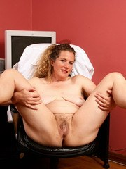 Mature woman Magnolia displays her unshaven body parts as she strips at home