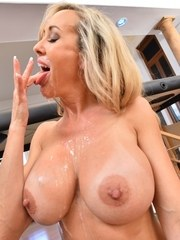 Big titted older blonde licks jizz from her fingers after giving a blowjob