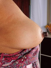 Older lady uncovers her tits and erect nips before showing her pink snatch