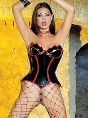 Hot Asian chick Tera Patrick strikes sexy poses in bustier and mesh stockings