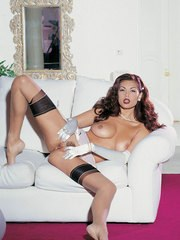 Top Asian pornstar Tera Patrick poses for naughty glam shoot on staircase