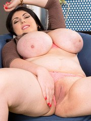 Brunette BBW Maya Milano exposes her massive boobs as she undresses