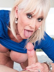 Blonde granny Leah LAmour takes the ball sac in her mouth while giving a BJ