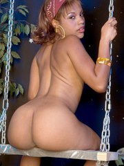 Black female Talana Gold flaunts her juicy ass on a swing in sneakers