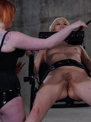 Redhead female tortures a blonde lesbian with hot wax play