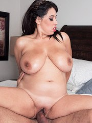 Chubby brunette Elle Flynn has her hooters oiled up before fucking
