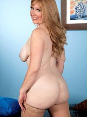 Chubby older lady Heather Barron fingers herself in tan nylons