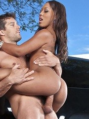 Black chicks with amazing asses get fucked in a driveway as the sun goes down