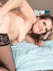 Middle-aged woman Cami Cline fucks her younger Latina lover in black stockings