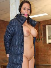Big boobed brunette is left ball gagged and handcuffed to a metal post